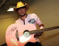 Jason Aldean.......and he's wearing pink