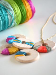 DIY Wooden Jewelry. Wooden washers wrapped with embroidery thread, Painted or colored with sharpies. Thread is the one I like best. via Craftzine.com