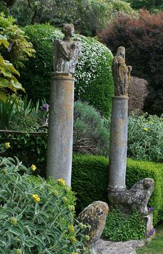 Statues on columns make a striking focal point at Iford Manor, the home of the late Harold Peto at Bradford-on-Avon, Somerset, BA15 2BA. www.ifordmanor.co.uk
