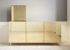 The Brass Cabinet : The Apartment Ilse Crawford United Kingdom, 2014 Cocktail cabinet in brown oak wood and polished brass.