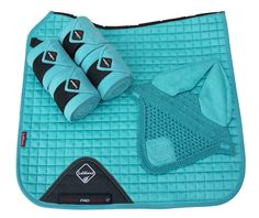 Match some of the stunning new LeMieux colours together and get this season's best look! This set comprises of set of quality polo bandages and an eye catching fly hood to go with one of the luxurious suede dressage squares. Our matchy, matchy collections will lend great style to your horse . N