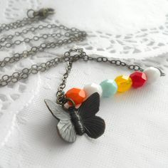 Rhythm  Colorful Butterfly Necklace. Inspired by life changes, each color in this necklace has meaning...
