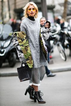 The Best Street Style From Couture Spring '17 #refinery29 http://www.refinery29.uk/2017/01/137746/couture-spring-best-street-style#slide-18 Still not sure how to wear winter layers well? Try fishnet tights under a midi skirt, worn with a chunky knit over a polo, finished off with a puffer jacket. Et voilà....