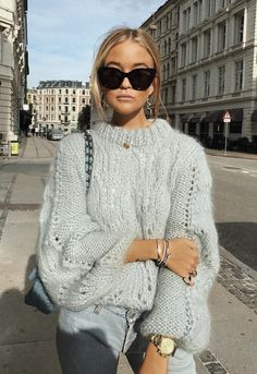 cool girl vibes #oversized sweaters with big shades, layered bracelets, and light wash jeans