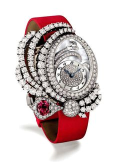 breguet  The diamond-set Breguet Marie Antoinette Dentelle is set with a 1.30 carat ruby matching the satin strap.
