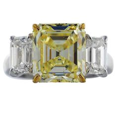 5.28 Carat GIA Emerald Cut Canary Diamond Gold Platinum Ring | From a unique collection of vintage three-stone rings at https://www.1stdibs.com/jewelry/rings/three-stone-rings/
