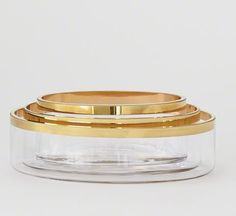 The Gold Band Oval Bowl Set by Global Views features a rimmed edge detail with a metallic gold finish, these sleek glass nesting bowls offer an elegant take on serveware. FREE SHIPPING. $173