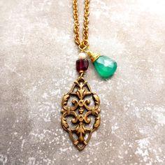 Vintage brass filigree drop topped with garnet, Swarovski pearl & green onyx stones, on vintage brass chain. Lauren Embree Jewelry
