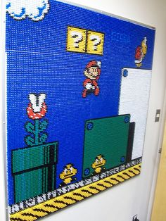 giant push pin mario mosaic — my coworkers made something similar for me on a particularly bad day: http://www.flickr.com/photos/thechimes/3931346315/