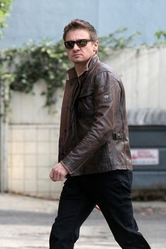 Jeremy Renner is suave in a brown leather jacket while exiting a restaurant on Wednesday (February 11) in Los Angeles.