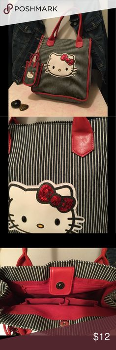 "Cute Hello Kitty Purse with Phone bag attached. The bag is blue and white striped denim material with faux leather handles. The bag is 10"" inches wide by 12"" inches high. Gently used and loved. One nick in purse handle as shown in photo. Phone purse is 5"" inches by 3""inches. Bags Totes"