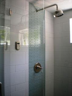 luxurious tile shower design ideas for your bathroom 34 < Home Design Ideas Shower Accent Tile, White Tile Shower, White Tiles, Shower Tiles, Shower Faucet, Vertical Shower Tile, White Glass Tile, Grey Tiles, Basement Bathroom