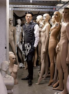 Kevin Arpino surrounded by mannequins