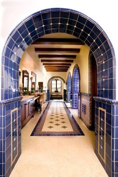 "Wow, not sure if this is a commercial bathroom area, or a huge home bathroom.  However, this is such a pop of color it says ""welcome"", and directed with the tilework.  So beautiful.  Beautiful Mediterranean work, could also be suited to a Spanish design, I am sure.  Houzz.com.  wonderful site."