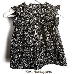 Ruffle sleeve blouse for toddler girls.