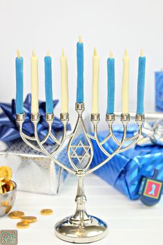 Over the years, we here at Oh Nuts have done a lot of fun and creative Hanukkah recipes, if I do say so myself. We've shared recipes for homemade chocolate gelt Hanukkah Food, Hanukkah Recipes, Homemade Chocolate, White Chocolate, Menorah Meaning, Menorah Candles, Oil Light, Blue Gel, Gel Food Coloring