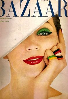 The kelly green eye shadow + the stack of vibrantly hued rings...fabulous! #vintage #fashion #1950s #magazine