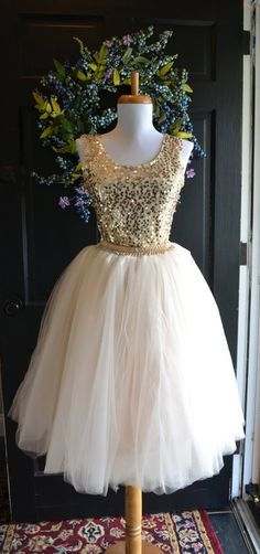 Beautiful tulle skirt in womens sizes. Skirt is made of layers and layers of the highest quality champagne tulle and is fully lined with a deep beige/champagne satin for a dimensional look and has an