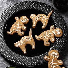 "Gingerbread Skeletons Recipe -Any small gingerbread boy cookie cutter can take on new ""life"" with these classic cookies. Give him some cat friends, too. The more the merrier! —Dore' Merrick Grabski, Utica, New York"