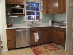 Furniture, Astounding Natural Solid Oak Cabinet Finished Color With White Granite Countertops And Small White Window Glass With Sweet Kitche. Blue Gray Kitchen Cabinets, Teal Kitchen, Kitchen Wall Colors, Painting Kitchen Cabinets, Corner Cabinets, Kitchen Cupboards, Staining Oak Cabinets, Honey Oak Cabinets, White Granite Countertops