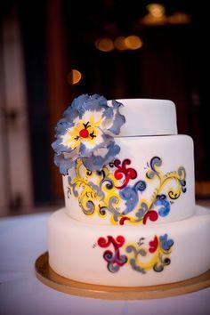 pretty painted cake. love the swirl design.