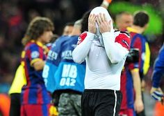 Manchester United's English forward Wayne Rooney reacts at the end of the UEFA Champions League final football match FC Barcelona vs. Manchester United, on May 28, 2011 at Wembley stadium in London.Barcelona won 3 to 1.