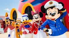 Mickey as a skipper and Minnie as a cruise director leading sailors Donald, Pluto and Goofy