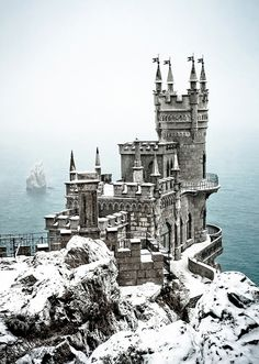 """A beautiful castle,built on a cliff at the ocean. In the distance you can see the peak of a bolder resting atop of the ocean waves. Heavy fog covers the far distance with a haze. I hope one day to build my own castle. Castles like this one """"Swallow's Nest"""" near Yalta, Ukraine are important historical monuments to society"""