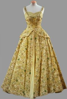 Gown, Norman Hartnell: 1959, with crinoline skirt heavily embroidered with beads and sequins. Worn by HRH Queen Elizabeth II.