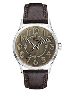 The Frank Lloyd Wright Exhibition Bronze Watch design is adapted from the Exhibition typeface that was developed by Wright in the 1930's for use in exhibitions of his work.