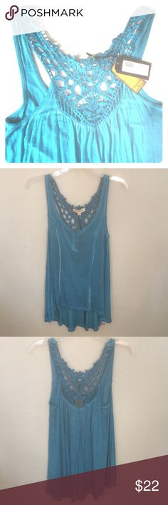 Blue Lace Detail Tank This tank is the perfect shade of blue and detailed with a beautiful Lace back. Top has a slight high low shape and is perfectly flowy. Measurements: Front- 25.5 inches Back- 30 inches Black Swan Tops Tank Tops