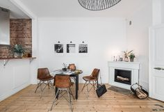 Lovely small home for sale by real estate agency Lundin. Filled with photographes and (vintage) camera's, this must be the home of a photographer. Images via Lundin