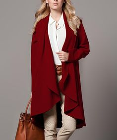 Polkadot Burgundy Swing Duster | zulily -  $49.99 $128.00  Product Description:  An open placket and side pockets add minimalist style to this duster, while draping ruffles combine with a voluminous silhouette to showcase clean lines and a roomy fit.  Size note: This item runs in European sizing. Please refer to the size chart.      72% polyester / 25% viscose / 3% Lycra spandex     Hand wash; dry flat     Imported