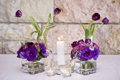 Decoration Courthouse Restaurant Beautiful Blue And Pueple Flowers Arrangemnt Put In Square Glass Floating Flowers Vases Tall Glass Floating Candles Holder And Vases White Table Natural Stone Wall These Awesome Floating Vases Are Practically Invisible