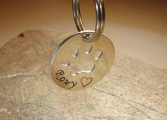 Sterling silver dog tag with paw and personalized by NiciLaskin, $28.00