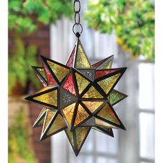 The many-pointed Moroccan star is the inspiration for this multicolored lantern. Insert a tea light or votive to set the jewel-tone panels aglow!