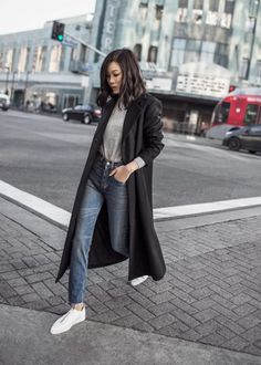 Jenny Tsang keeps it sleek, casual and authentic in this smart winter style consisting of mom jeans, a grey sweater and a tomboy style maxi coat. We love the charmingly boyish nature of this look! Coat: The Fifth Label, Top: Banana Republic, Jeans: ReDone.