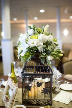 White colored theme: candle on the inside; bouquet of variety of white-colored flowers on the outside (tip-top)!