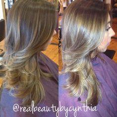 Face framing highlights warm light caramel tone on dark brown hair with layered cut | Yelp