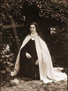 "Saint Therese of Lisieux, ""The Little Flower"" 1873 - 1897 Carmelite of Lisieux, better known as the Little Flower of Jesus, born at Ale. Sainte Therese De Lisieux, Ste Therese, Ignatius Of Antioch, St Ignatius, Image Du Christ, St Therese Prayer, Pope Pius Xi, Jesus Painting, Way To Heaven"