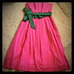 🎀Lilly Pulitzer 🎀Pink w/ striped sash 🎀dress! This dress is divine! I've never gotten to wear it, but bought it in perfect condition from a fellow posher! It's a tad too big & I'm so sad because I love it! The first picture showcases the back of the dress! 💓 Lilly Pulitzer Dresses Strapless