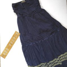 "SALEFree People Strapless Maxi Dress This is Gorgeous strapless navy blue maxi dress by Free People.   Fully lined with ruched (stretch) upper back and  waist. Very pretty sage colored embroidery on bottom and scalloped trim edge.  Dress is super flattering and very comfortable!!! Excellent condition!  Poly/Cotton Blend  Measures: 13"" across unstretched (underarm to underarm)  14"" waist unstretched 41"" Length Free People Dresses Maxi"