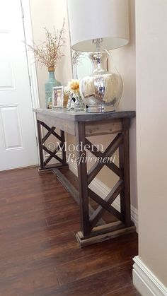 Stunning handmade rustic farmhouse entryway table, sofa table, buffet table. Just the right accent piece to add to your home. This item is handmade, solid wood and treated with a lovely weathered stain. It has a protective finish to bring out the woods natural beauty. These tables can be customized with any dimensions as well as color combinations. Message me for more details.  Dimensions 60 wide 30 tall 14 deep  Entryway table. Buffet table. Farmhouse. Rustic. Sofa table. Table. Entrway…