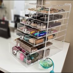 Cutie Cube (Luxe) Acrylic Makeup Organizer LRG. www.TwinLilies.com Our Clear Acrylic Makeup Organizer is the perfect cosmetic storage product for your collection. With Sliding drawers and a Flip-Top design it makes finding what you need simple and easy. FEATURES - 100% USA Made in Tampa, FL out of USA sourced materials - Luxurious Premium Handles - Larger Bottom Drawer for larger items - Flip-Top Lid can lay flat against the back of the organizer when left open. DIMENSIONS 18'' H x 11'' L x…