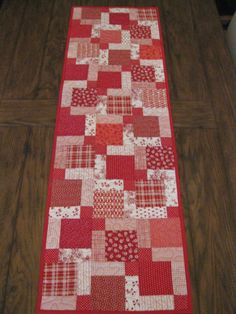 Perfect table runner for a country, farmhouse or cottage style kitchen...a variety of cotton fabrics in reds and white will look great with a collection of candle sticks, wild flowers or seasonal greens. Works well on a dresser, sofa table or coffee table too.  The fabrics are all 100% cotton home fabrics with red binding. Machine wash and dry, can be ironed on a cotton setting.  This table runner measures about 16 1/2 x 53  Made in my smoke free studio and is ready to ship.  Thank you for…