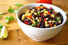Black Bean Salad  2 cans 15 oz black beans 1 15oz can corn drained/rinsed 1 med red pepper 1/4 c. fine chopped cilantro 1/4 c fresh lime juice  Combine, toss with juice. Chill 1-2 before serving.