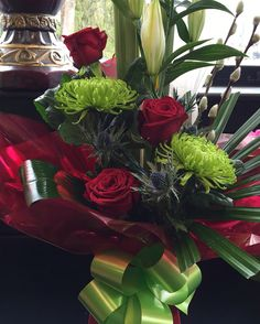 Beautiful arrangement with niaomi roses and green blooms