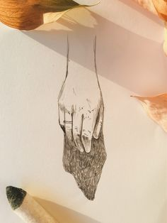 Hand sketch and dry leaves