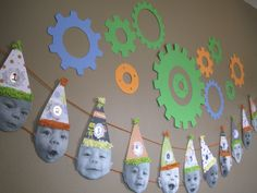 Cute party decoration idea--have photos of the birthday boy/girl either each month for first year or each year for the b-day.