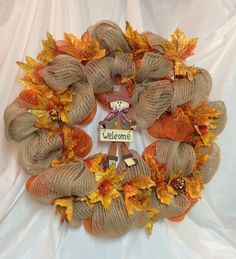 "Autumn mesh wreath. Orange, tan mesh, 8x4"" wood scarecrow in center. Gold maple leaves, burlap finish back. 20"" wreath. Chenille hanger. by KhQualityCreations on Etsy"